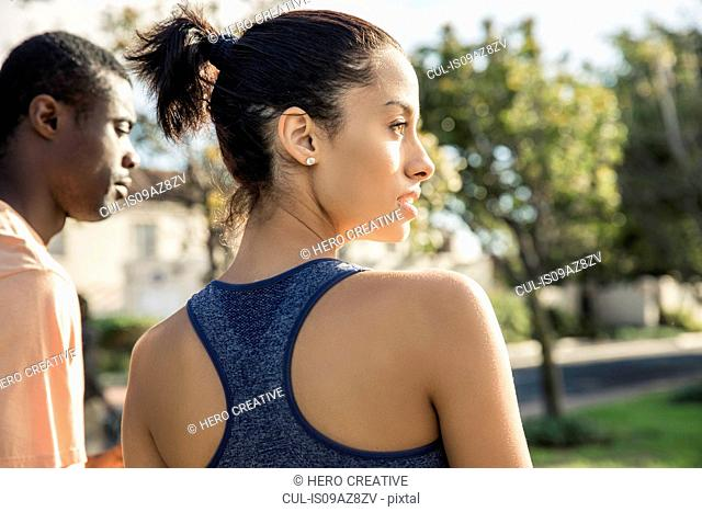 Rear view of woman wearing racerback vest looking away