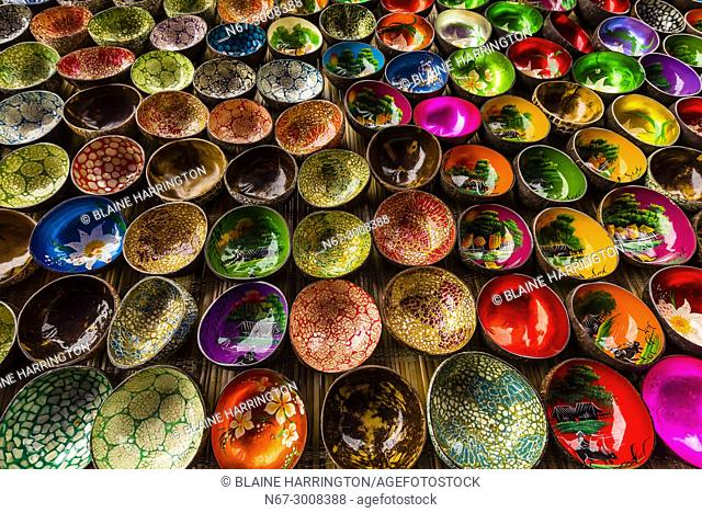 Colorful Vietnamese lacquer coconut shell bowls, Sunday market at Ba Ha, northern Vietnam. Every Sunday ethnic minorities come from surrounding villages and...