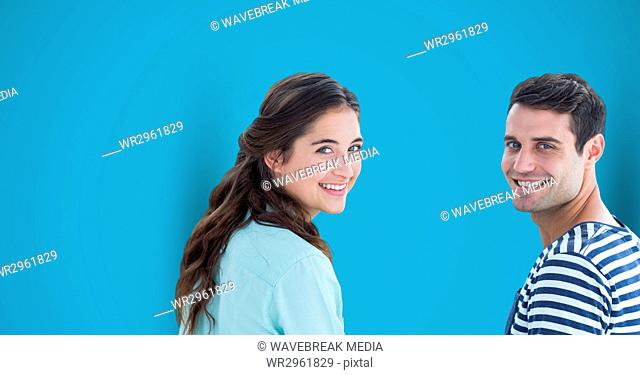 Happy male and female hipsters against blue background