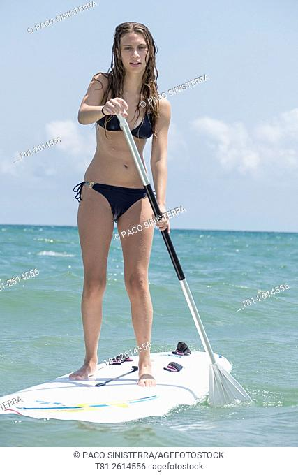 Young girl on paddleboard, Peñiscola, Spain