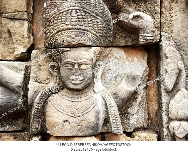 Fragment of bas-relief on Terrace of the Elephants in Angkor Thom temple complex. Angkor Archaeological Park, Siem Reap Province, Cambodia