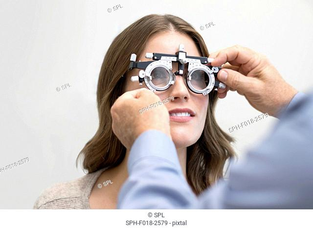 Woman wearing eyesight testing spectacles