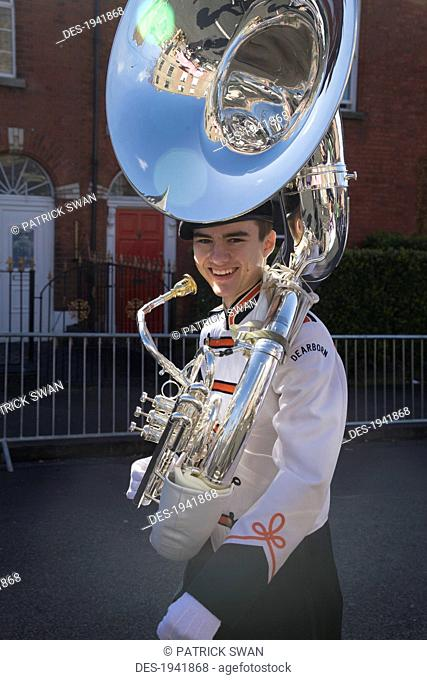 a member from a marching band in the saint patrick's day parade, dublin ireland