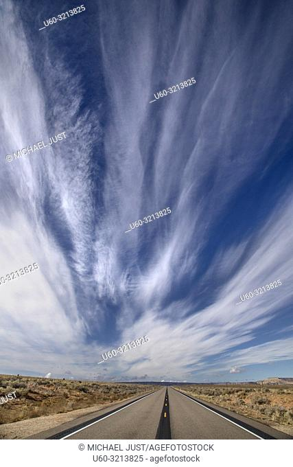 Dramatic and streaky clouds appear over the Souhern Utah landscape near Big Water
