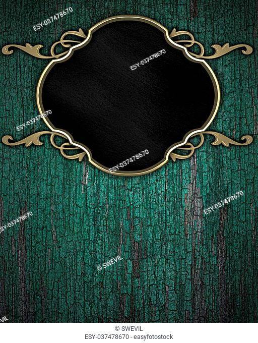 Gold Pattern on a black plate on a wood background