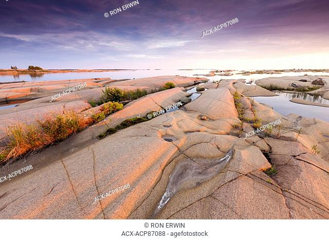 Pink granite rocks on the shores of Georgian Bay in French River Provincial Park, Ontario, Canada