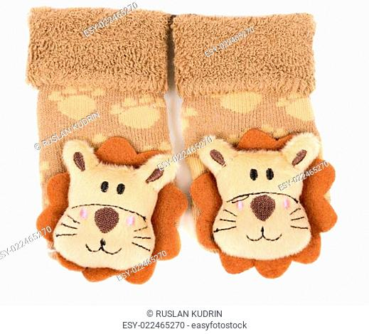 pair of children's sneakers with a muzzle of a lion