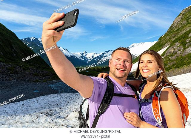 Couple taking a selfie at Byron Glacier. Portage Valley, Chugach National Forest, Alaska