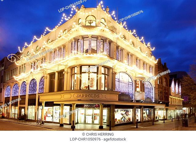 England, Norfolk, Norwich, Jarrolds Department Store illuminated at Christmas, on the corner of Exhange Street and London Street in Norwich City centre