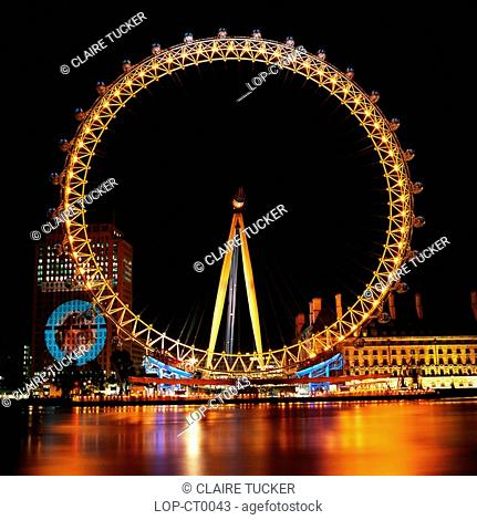 England, London, South Bank, The British Airways London Eye at Night. Opened in 1999, it stands 135m high making it the largest observation wheel in the world