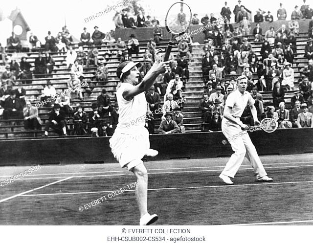 Americans Helen Wills Moody and Sidney Wood, in mixed doubles play in France. May 31, 1932. They placed second, losing the finals to Betty Nuthall and Fred...