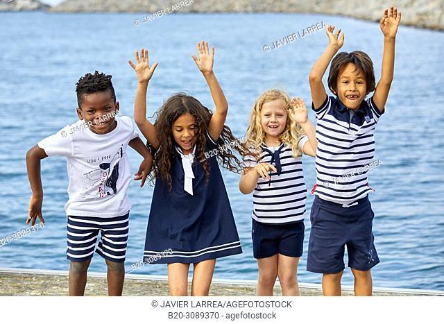 Children with sea clothes, Marina Urola, Santiago beach, Zumaia, Gipuzkoa, Basque Country, Spain, Europe