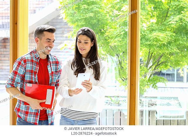 Pair of students with digital tablet, University, Donostia, San Sebastian, Basque Country, Spain