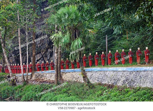 Myanmar, Kayin (Karen) State, Hpa-An surroundings, Monk statues line near Kaw Ka Thawng caves