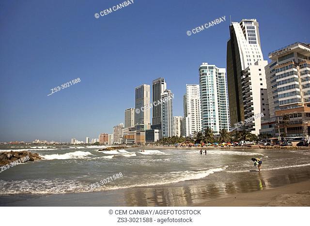 Beach scene and buildings in Boca Grande district, Cartagena de Indias, Bolivar, Colombia, South America