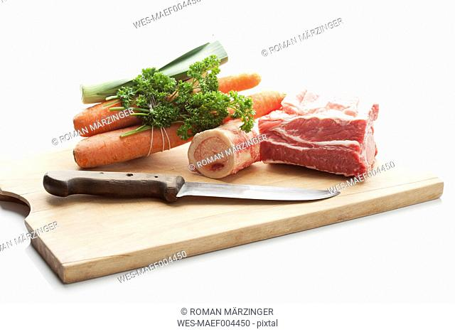 Beef broth ingredients on chopping board, close up