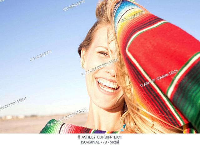 Portrait of young woman with blanket, Breezy Point, Queens, New York, USA