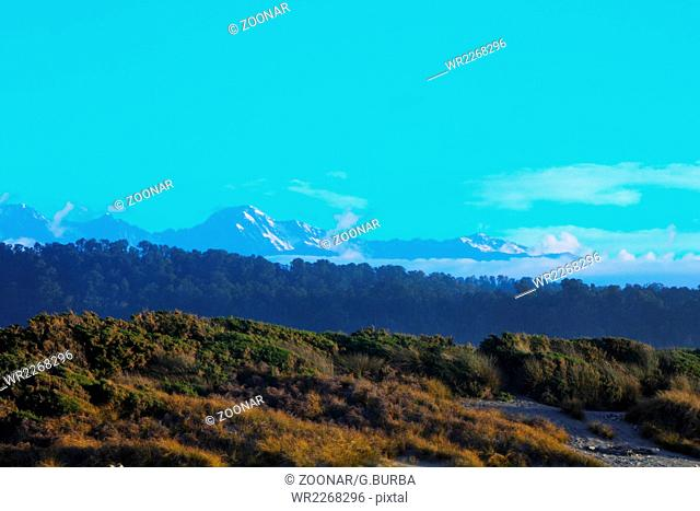 Mount Cook and Mount Tasman are seen from Gillespies Beach in Westland National Park