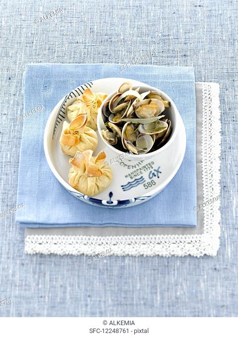 Clams with filled pastry parcels
