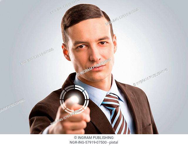 Business man pushing virtual button on touch screen