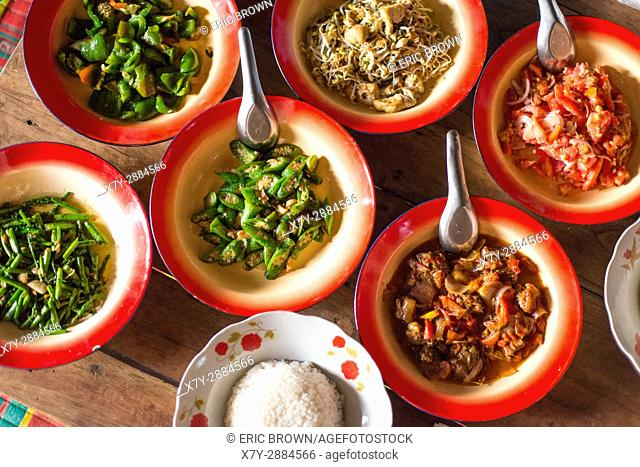 Bowls of food in small village in Myanmar