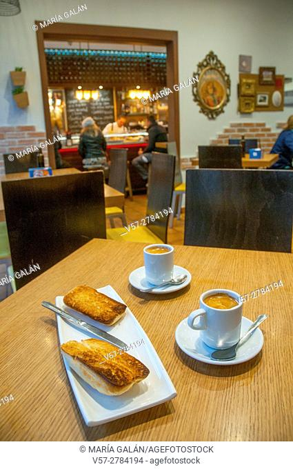Two cups of coffee and toasts in a cafeteria. Madrid, Spain