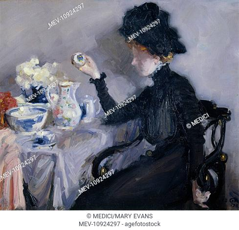 Jean in Black with China' – woman sitting at a table