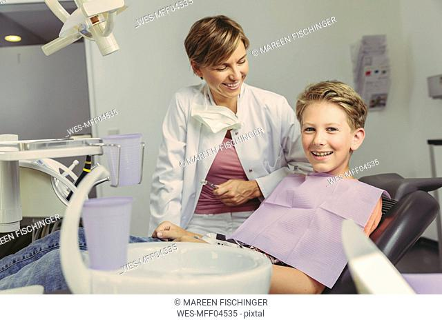 Boy smiling happily after treatment at the dentist