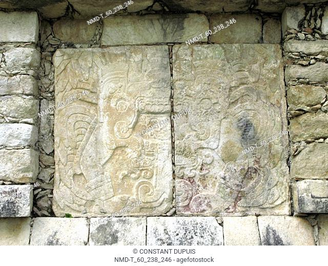 Carving on a stone wall, Chichen Itza, Yucatan, Mexico