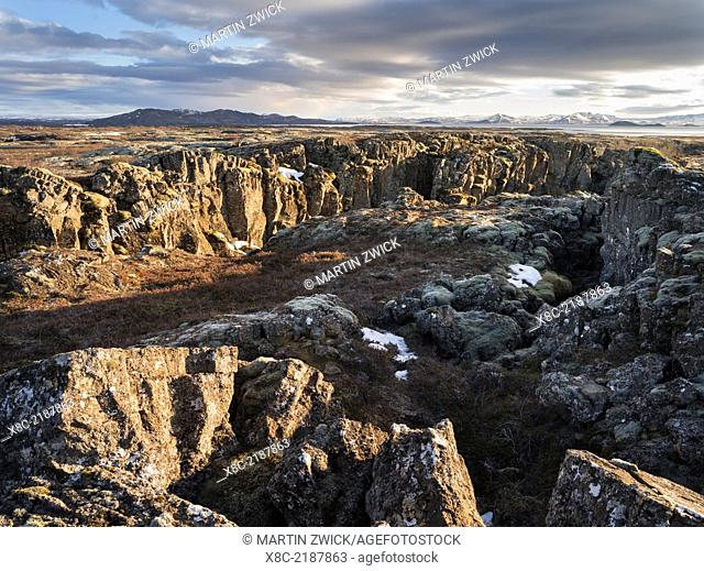 Thingvellir National Park in Iceland during winter. Thingvellir is listed as UNESCO world heritage site. The geologic fissure Flosagja during sunset
