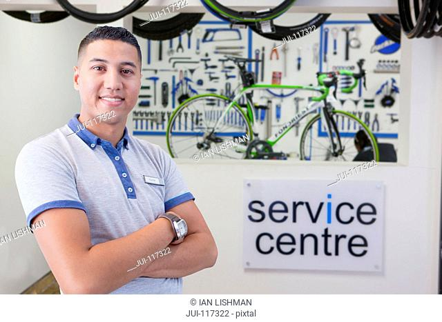 Portrait Of Male Sales Assistant In Cycle Repair Store