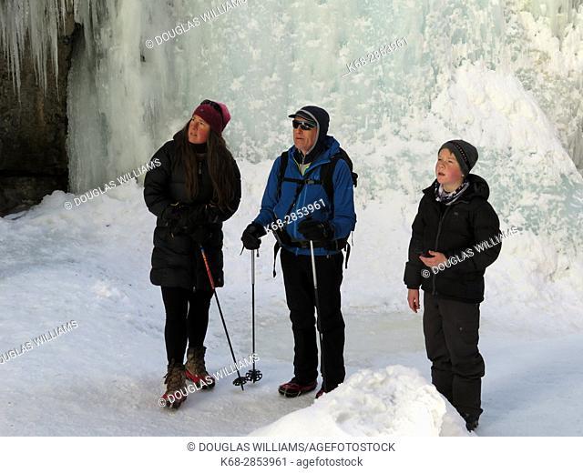 Family of three in the Maligne Canyon, Jasper, Alberta, Canada in winter