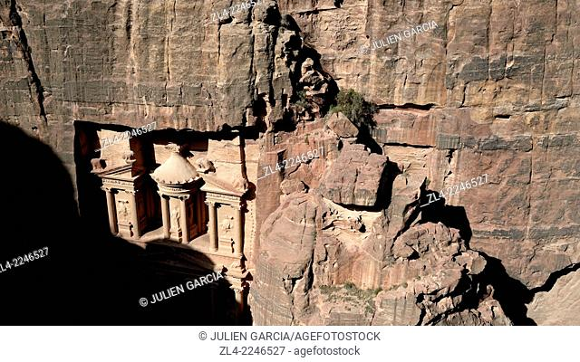 The famous and elaborately carved façade of Al Khazneh (the Treasury), carved out of a sandstone rock face, viewed from the mountain jebel Khubtha (Khubta)