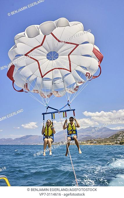 Couple during parasailing. Chersonissos. Crete, Greece