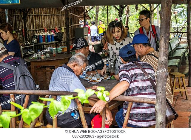 Tourists having drinks in Mekong Delta, Vietnam