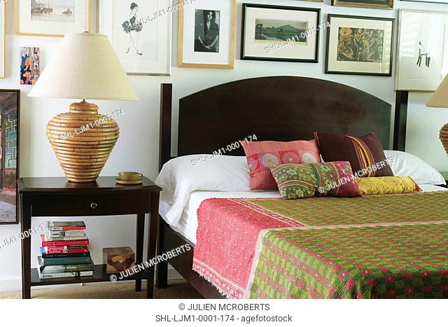 Pink and green bedspread in contemporary bedroom