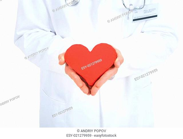 Doctor Holding Heart Over White Background