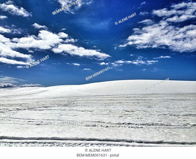 Clouds in blue sky over snowy landscape