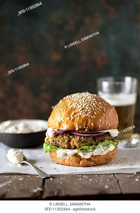 A burger with cream cheese and onions