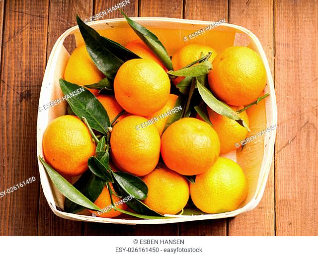 fresh organic clementines picked with green leaves