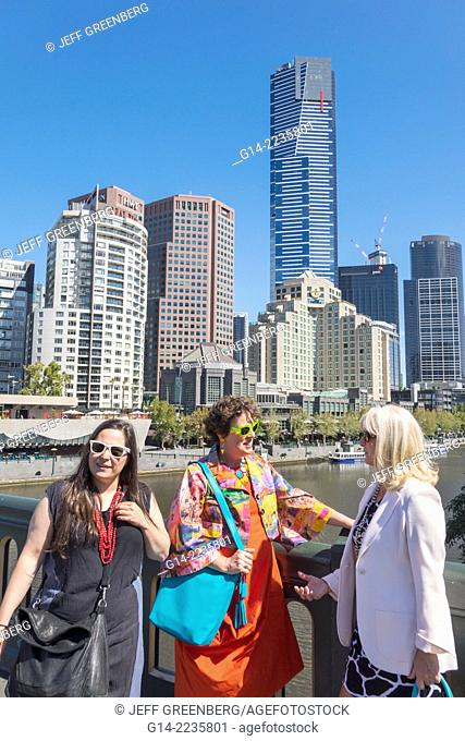Australia, Victoria, Melbourne, Southbank, Princes Bridge, St. Kilda Road, Yarra River, Eureka Tower, tallest building, city skyline, skyscrapers, woman