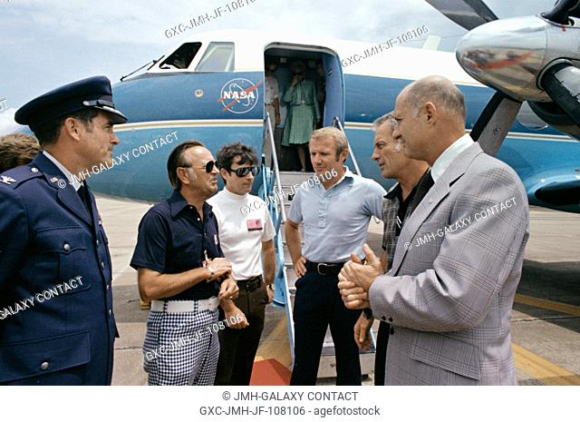 Dr. Christopher C. Kraft Jr. (second from left), JSC Director, chats with the three ASTP crewmen on the runway at Ellington Air Force Base after their arrival...