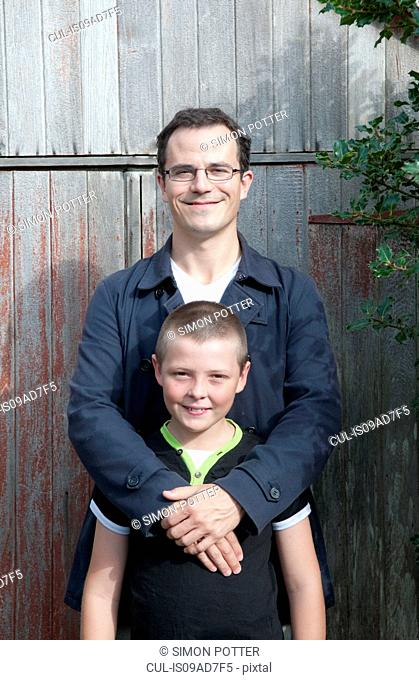 Portrait of father and son in garden