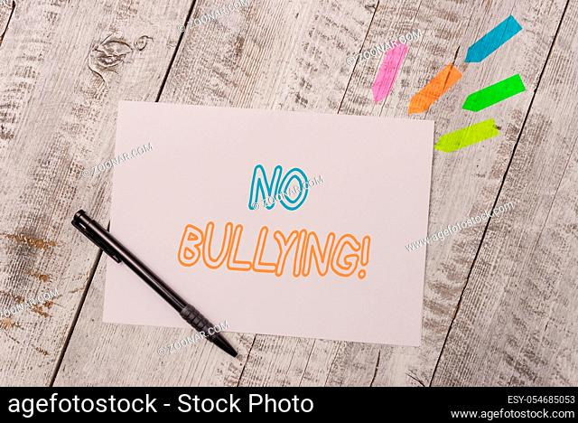 Handwriting text No Bullying. Conceptual photo stop aggressive behavior among children power imbalance Plain note paper and line arrow stickers with pen above...