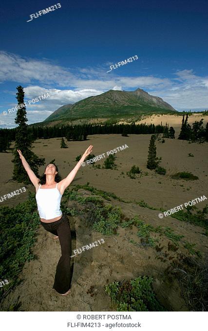 Woman doing Yoga Outdoors, Carcross Desert, Yukon