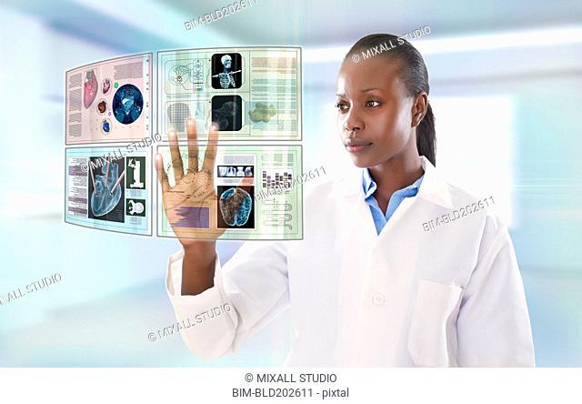 African American doctor using digital display