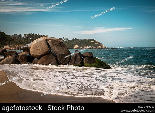The surf pounds the rocks on a beach in Colombia's Tayrona National Natural Park (Parque Nacional Natural Tayrona)