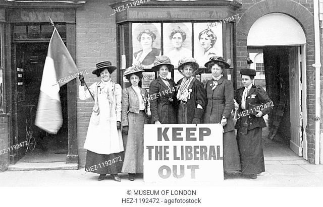 Suffragettes determined to 'Keep the Liberal Out' at the Cleveland by-election, 1909. The window of the temporary premises they rented for the by-election is...
