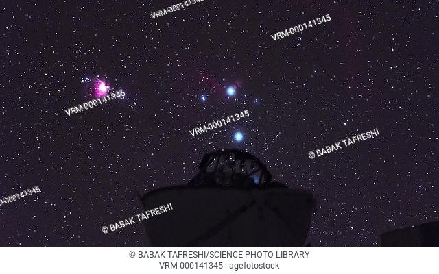Timelapse footage of the Orion nebula (pink, left) and the belt of Orion (the three aligned stars at right) setting behind a telescope