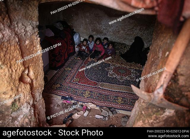23 February 2020, Syria, Idlib: Syrian children are pictured inside a cave at Taltouna village. At least eight families live in an ancient deserted cave after...